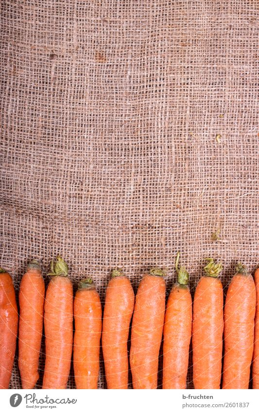 Carrots on a jute sack Food Vegetable Organic produce Vegetarian diet Slow food Healthy Eating Kitchen Packaging Sack Select Fresh Orange Quality Jute sack