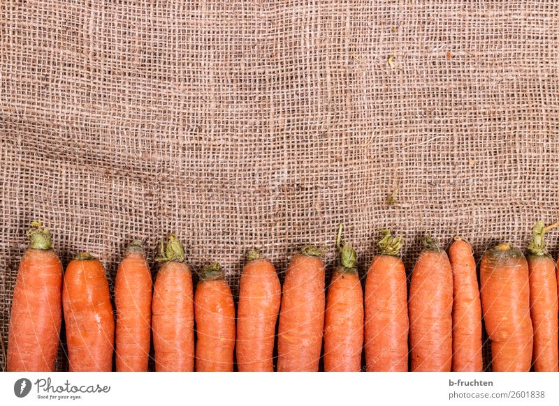 Fresh carrots Vegetable Nutrition Organic produce Garden Kitchen Autumn Sack Select Lie Sell Healthy Orange Row Carrot Root vegetable Vitamin Jute Vitamin A