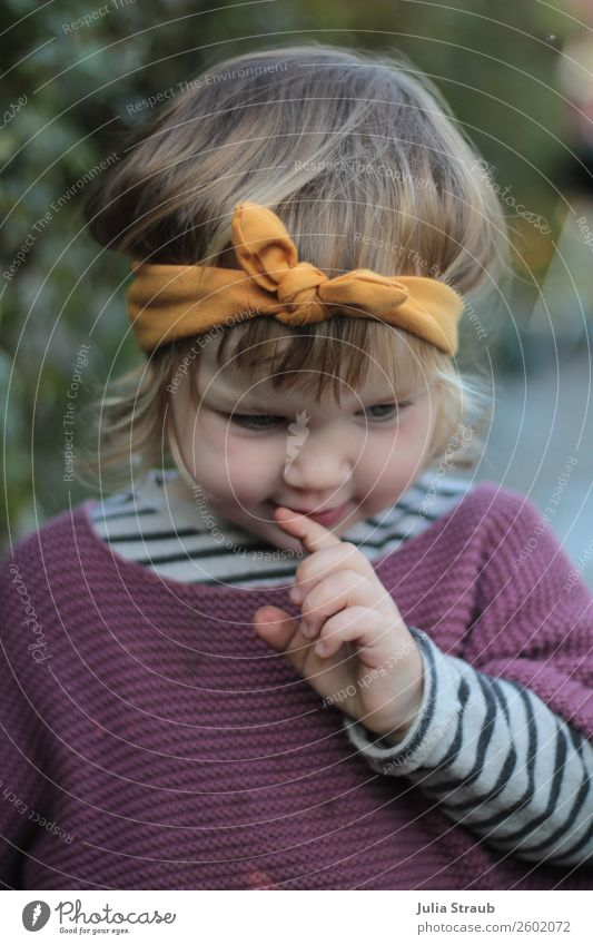 Girl with headband brooding Feminine Toddler girl 1 Human being 1 - 3 years Garden Sweater Knitted sweater Striped sweater Headband Bow brunette Blonde