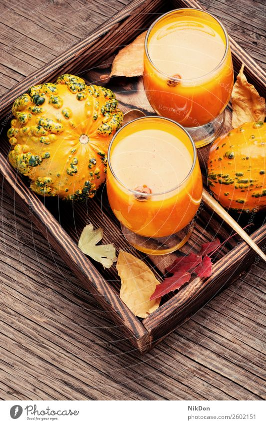 Healthy pumpkin smoothie drink autumn fall food glass vegetable beverage healthy orange fresh vegetarian sweet cocktail juice dessert rustic squash organic diet