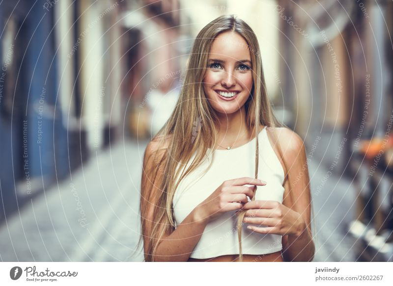 Young woman smiling in urban background. Woman Human being Youth (Young adults) Summer Beautiful White 18 - 30 years Street Lifestyle Adults Autumn Feminine