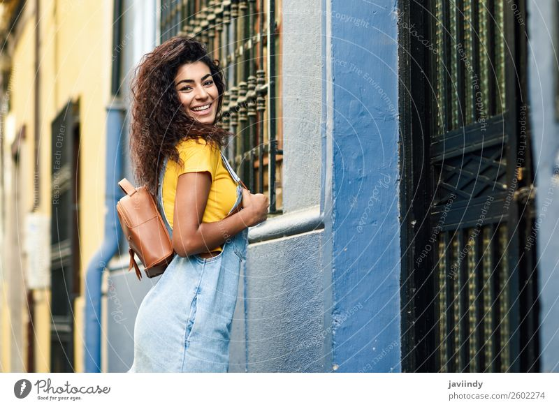 African woman with black curly hairstyle outdoors. Woman Human being Youth (Young adults) Young woman Beautiful Joy Black 18 - 30 years Face Street Lifestyle