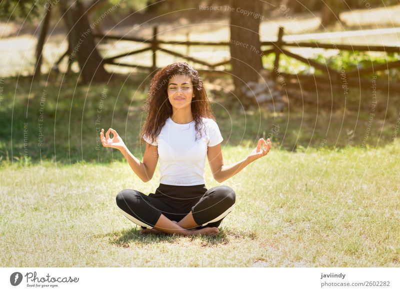 Young Arab woman doing yoga in nature. Lifestyle Happy Hair and hairstyles Relaxation Calm Meditation Summer Sports Yoga Human being Feminine Young woman