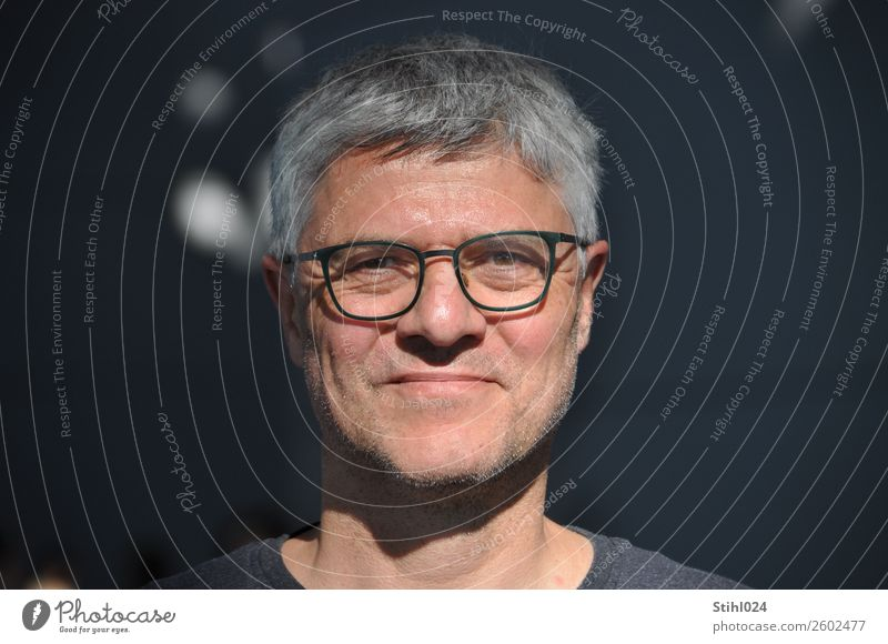 grey man in his fifties with glasses in the light in front of a dark background Masculine Man Adults Face 1 Human being 45 - 60 years Eyeglasses Gray-haired