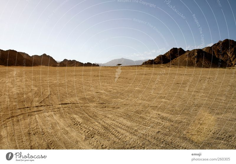 Sky Nature Yellow Environment Landscape Mountain Sand Warmth Earth Rock Climate Elements Desert Hill Dry Drought
