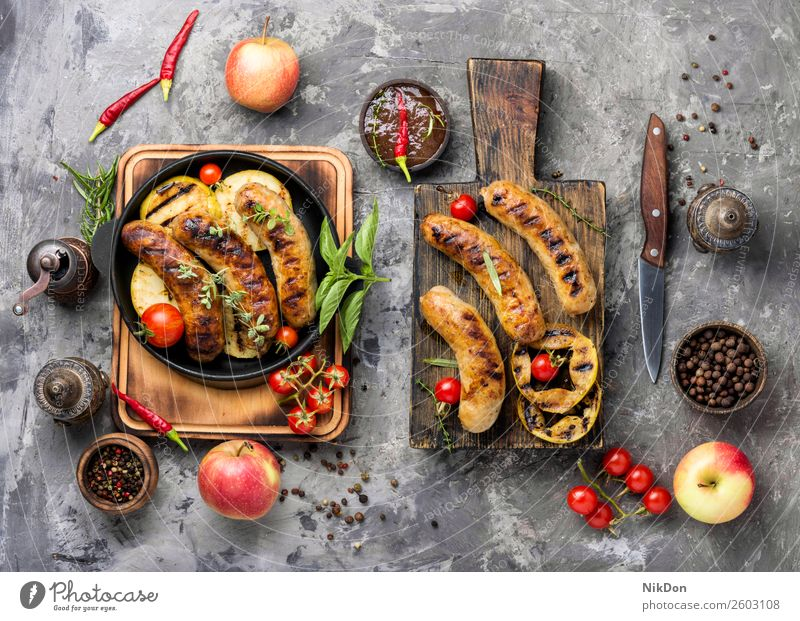 Grilled sausages on cutting board grilled meat barbecue food pork bbq meal dinner chilli roasted pan apple fruit beef sauce table spicy dish fried autumn