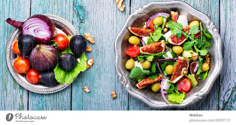 Dietary salad with figs green healthy fresh food cheese fruit organic arugula plate diet vegetable vegetarian ripe summer raw leaf autumn natural nut dieting