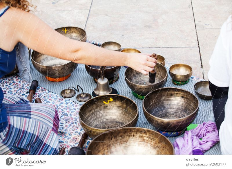 Hand playing yoga bowls outdoors. Bowl Lifestyle Medical treatment Alternative medicine Wellness Relaxation Meditation Spa Playing Music Yoga Human being Street