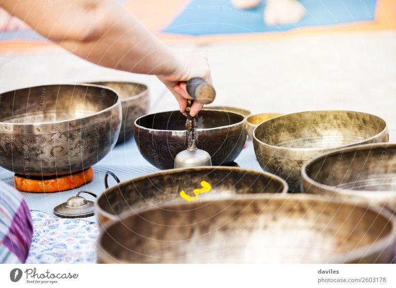 Hand playing yoga bowls outdoors. Bowl Lifestyle Wellness Relaxation Meditation Spa Playing Music Yoga Metal Energy singing Healing Sound tibetan Therapy