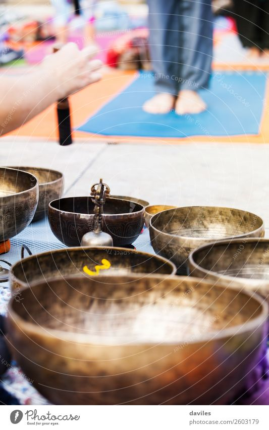 Hand playing yoga bowls outdoors. Bowl Lifestyle Medical treatment Alternative medicine Wellness Relaxation Meditation Spa Leisure and hobbies Music Yoga Metal