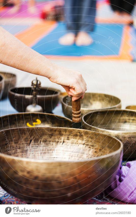 Tibetan bowls sound. Bowl Lifestyle Wellness Harmonious Well-being Relaxation Meditation Music Yoga Human being Hand 1 Street Metal Movement Playing Energy