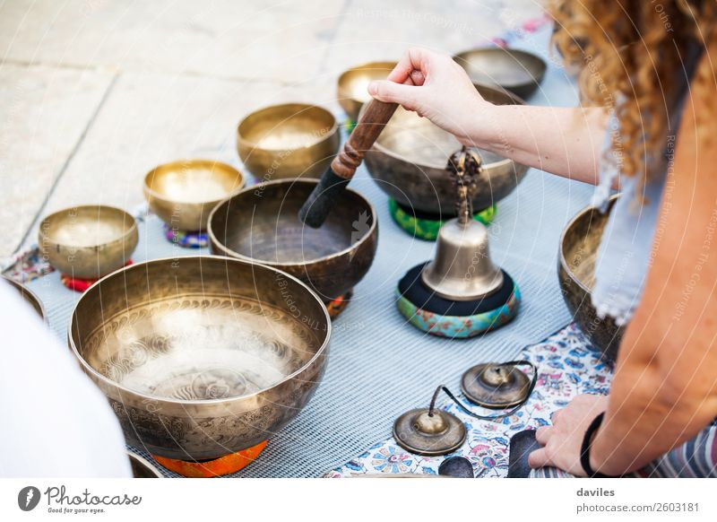 Woman playing tibetan bowls Bowl Lifestyle Alternative medicine Wellness Well-being Relaxation Meditation Music Yoga Human being Hand 1 30 - 45 years Adults Art