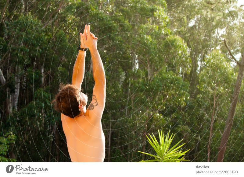 Man doing yoga in nature. Lifestyle Wellness Harmonious Relaxation Calm Meditation Summer Yoga Human being Masculine Adults Back Arm 1 30 - 45 years Nature