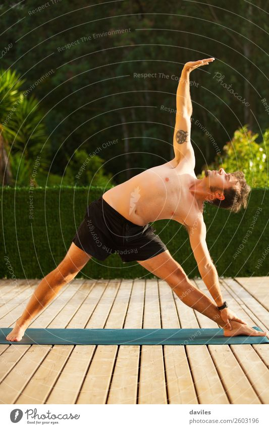 Man doing yoga in nature. Human being Nature Summer Relaxation Calm Lifestyle Adults Leisure and hobbies Masculine Body Wellness Harmonious Serene Meditation