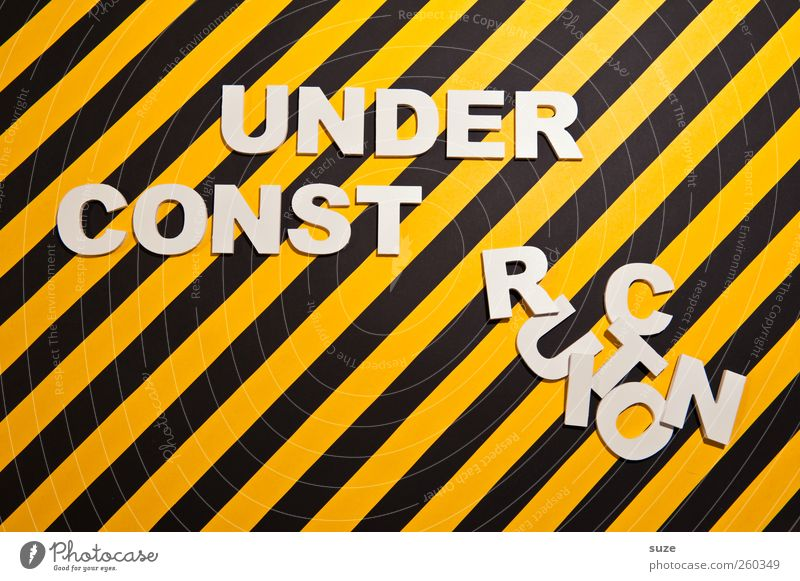 White Black Yellow Funny Design Characters Signage Stripe Construction site Letters (alphabet) Creativity Warning label Idea Typography Striped Word