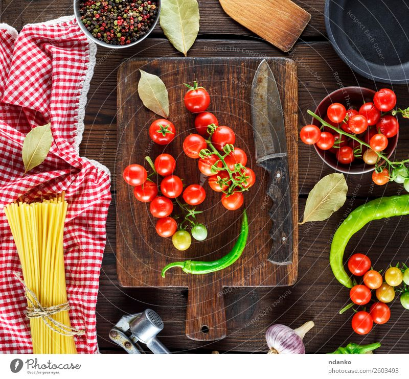 spaghetti and red cherry tomatoes Vegetable Dough Baked goods Dinner Table Wood Fresh Yellow Red pasta food background Raw Spaghetti Tomato cooking Cherry