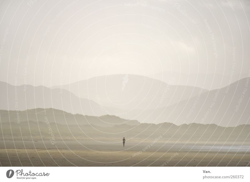 Human being Sky Vacation & Travel Ocean Beach Loneliness Calm Far-off places Environment Landscape Mountain Freedom Sand Coast Weather Earth