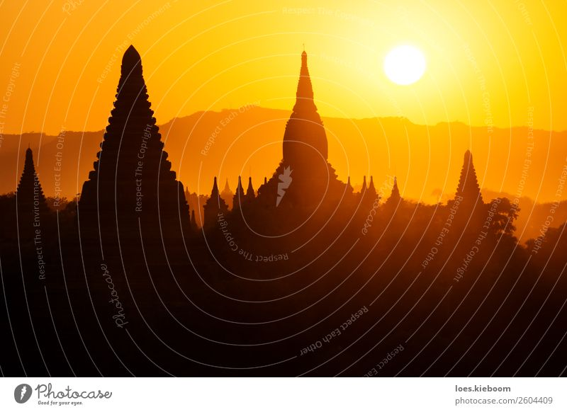 Silhouettes of Burmese Pagodas during sunset, Bagan, Myanmar Vacation & Travel Tourism Adventure Far-off places Sightseeing Summer Nature Sun Sunrise Sunset