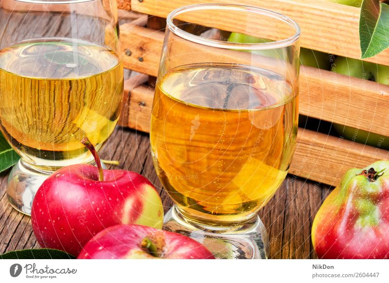 Homemade cider from ripe apples fruit drink ingredient alcohol food glass liquid juice fresh beverage autumn wooden rustic natural table nature delicious