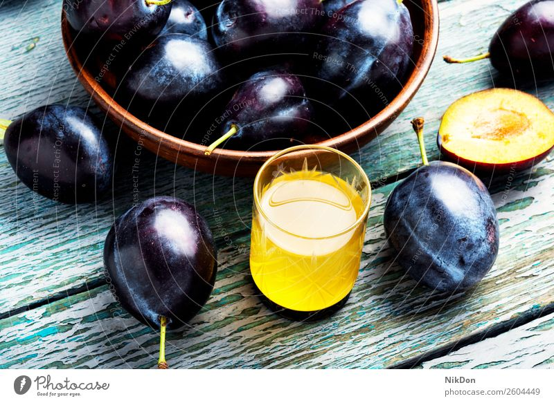 Plum alcoholic beverage plum rakia glass fruit drink food sweet tasty brandy homemade autumn traditional liquor ripe summer purple closeup liqueur plum brandy