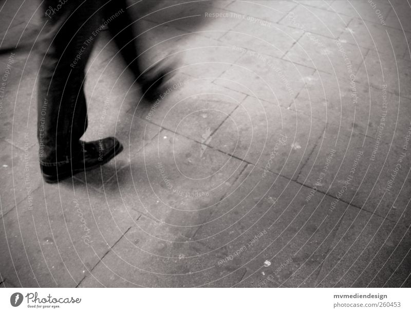 Hectic, stress and always on the move. Masculine Legs Feet 1 Human being Town Sadness Longing Movement Loneliness Stress Haste Walking Black & white photo