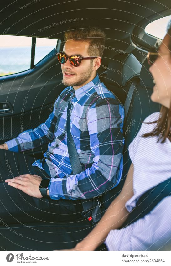 Young couple traveling by car with seat belts on Lifestyle Beautiful Leisure and hobbies Vacation & Travel Trip Human being Woman Adults Man Friendship Couple