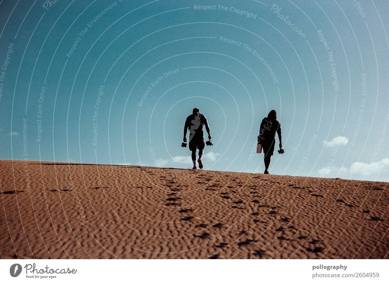 Friendship II Lifestyle Leisure and hobbies Hiking Masculine 2 Human being Nature Earth Sand Sky Summer Desert Going Esthetic Beautiful Blue Colour photo