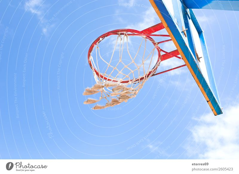 A Basketball Net at a Playground Ball Baseball Sports Street Playing Hop Relaxation Sky Exterior shot Park Track and Field backboard