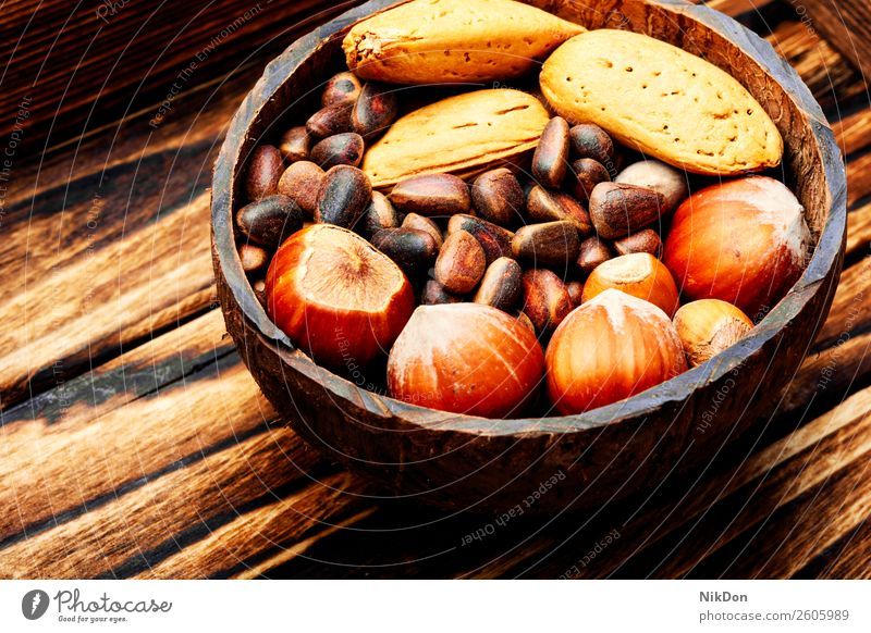 Assorted mixed nuts almond food ingredient hazelnut cashew seed healthy snack vegetarian fruit organic natural closeup brown bowl vegan nutrition raw tasty