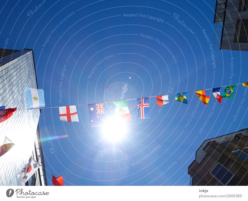 Flag in the wind 2 Sky Cloudless sky Sun Sunlight Beautiful weather Town Deserted House (Residential Structure) High-rise Decoration Ensign Paper chain Blue