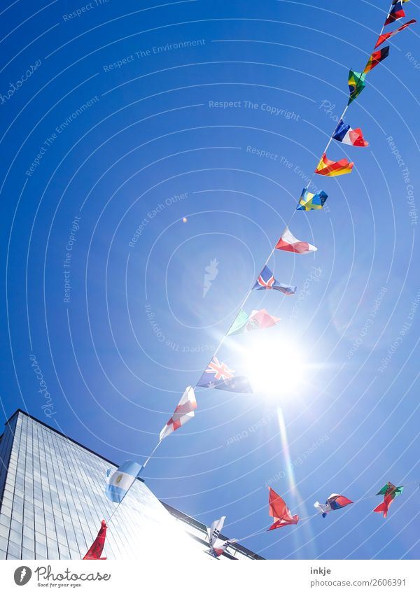 Flag in the wind 1 Cloudless sky Sunlight Beautiful weather Town Deserted High-rise Decoration Paper chain Ensign International Cosmopolitan Blue Multicoloured