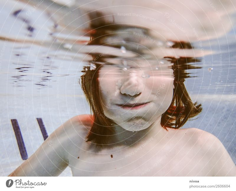 Half Underwater Portrait of a Boy Hair and hairstyles Skin Face Swimming pool Swimming & Bathing Leisure and hobbies Playing Dive Child Human being Masculine