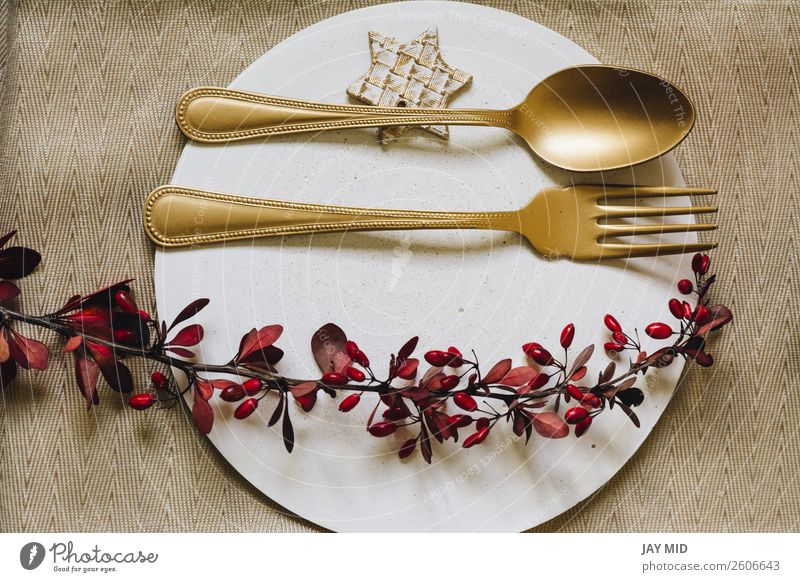 Holiday Gold place setting plate with fork and golden spoon. Dinner Plate Fork Spoon Elegant Winter Decoration Table Restaurant Feasts & Celebrations