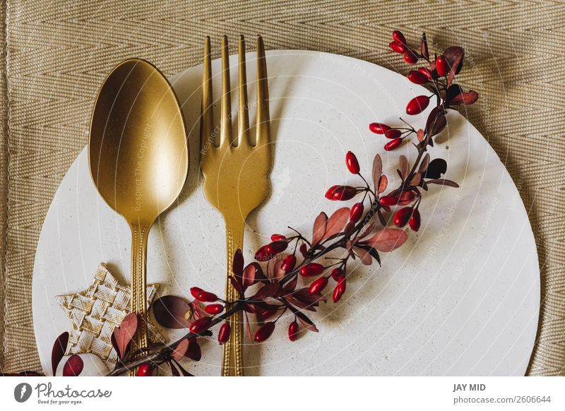 Holiday Gold place setting plate with fork and golden spoon. Dinner Plate Fork Spoon Elegant Winter Interior design Decoration Table Event Restaurant