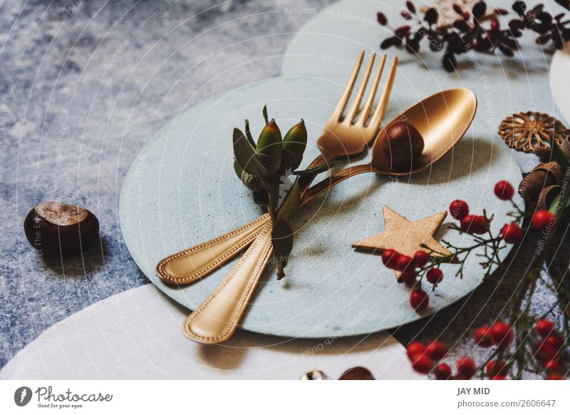 christmas table setting, golden cutlery and nandinas Dinner Plate Fork Spoon Winter Decoration Table Restaurant Feasts & Celebrations Thanksgiving