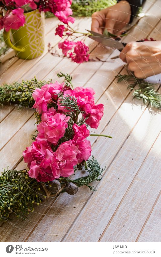 Florist Creating a wooden wreath with pine branches and flower Handicraft Decoration Feasts & Celebrations Valentine's Day Mother's Day Thanksgiving