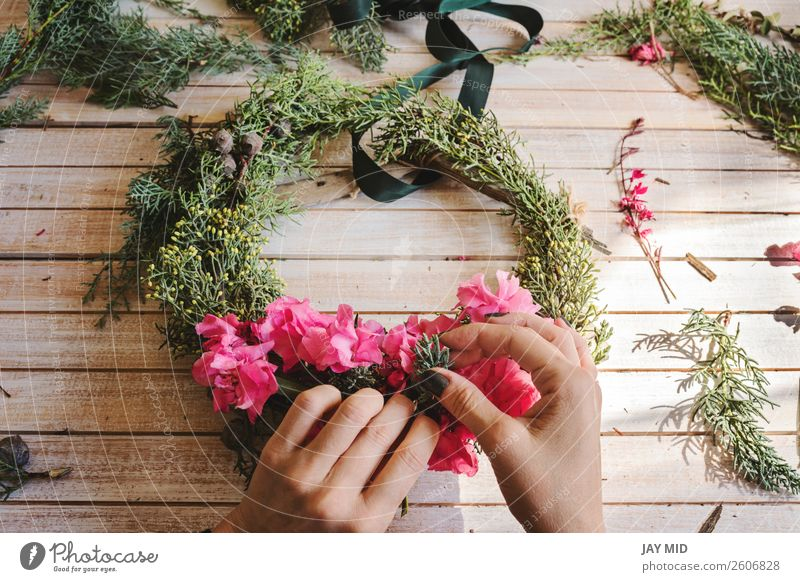 Creating a wooden wreath with branches pine and pink flowers Decoration Thanksgiving Christmas & Advent New Year's Eve Work and employment Craft (trade) Woman
