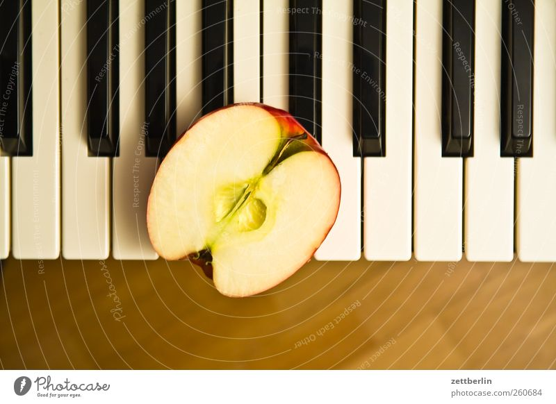 Piano on half apple Food Apple Organic produce Vegetarian diet Leisure and hobbies Playing Music Art Keyboard Fresh Senses Half Tone Vitamin wallroth
