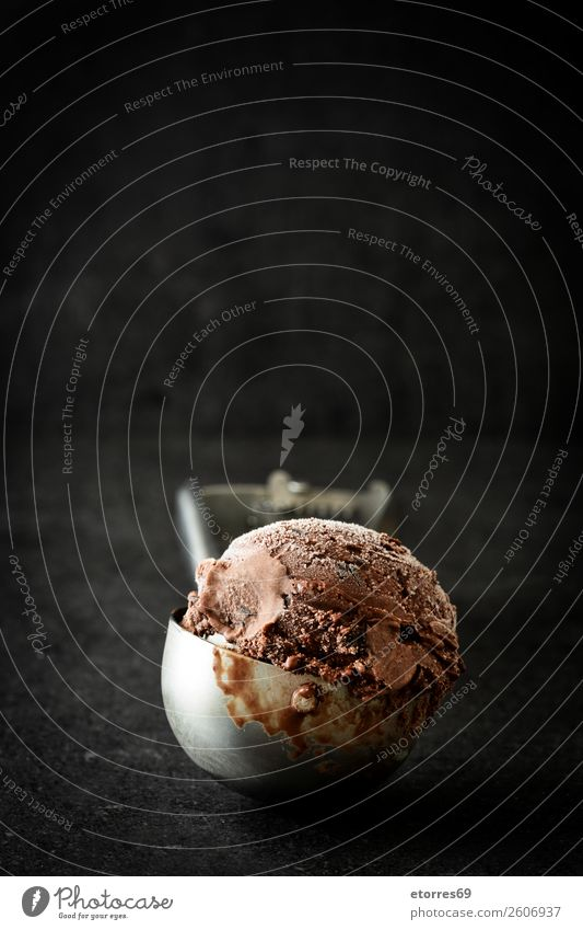 Chocolate ice cream on black stone background Ice cream Sweet Candy Summer Cream Scoop Dessert Frozen Rich Cold Rich in calories Brown Confectionary Food