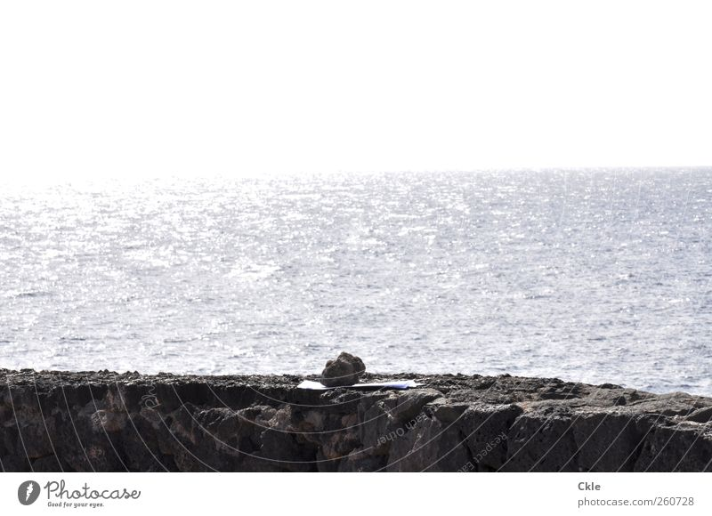 Sky Blue Water White Ocean Loneliness Calm Far-off places Wall (building) Gray Stone Coast Wall (barrier) Earth Horizon Wait