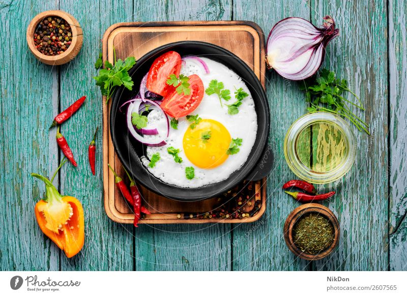 Tasty food fried egg pan morning breakfast grilled egg yellow meal healthy yolk protein lunch cholesterol table dish delicious cook diet kitchen pepper fry eat