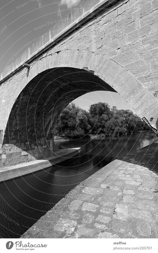Black and white channel at Adobe Bridge Beautiful weather River Danube Regensburg Old town Tourist Attraction Lanes & trails Stone Strong Robust Defensive Arch