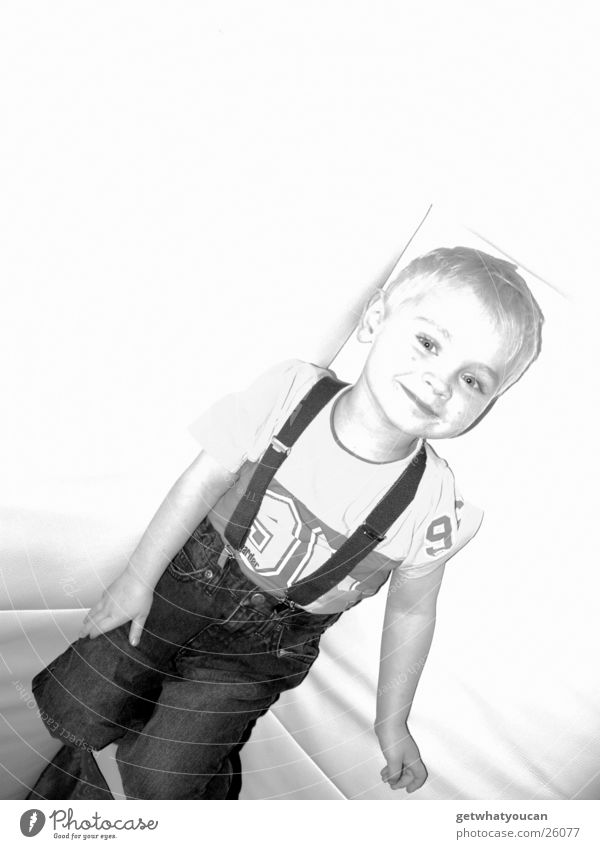 rebuffed Child Sofa Leather White Flashy Suspenders Boy (child) Bright Reflection Grinning Laughter Lie Joy