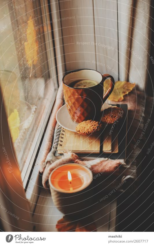 cozy autumn morning at home. Hot tea and candle Breakfast Coffee Tea Lifestyle Relaxation Reading Book Autumn Winter Weather Rain Safety (feeling of)