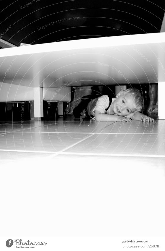 Underground Child Table White Flashy Narrow Flat Search Find Boy (child) Floor covering Tile Bright Lamp Hide Lie Looking Black & white photo Table edge