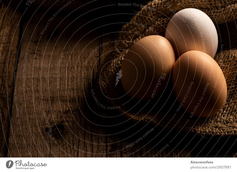 Fresh eggs on wooden dark table Food Nutrition Decoration Table Easter Nature Cloth Wood Natural Brown White Creativity Tradition Composition Gift agriculture