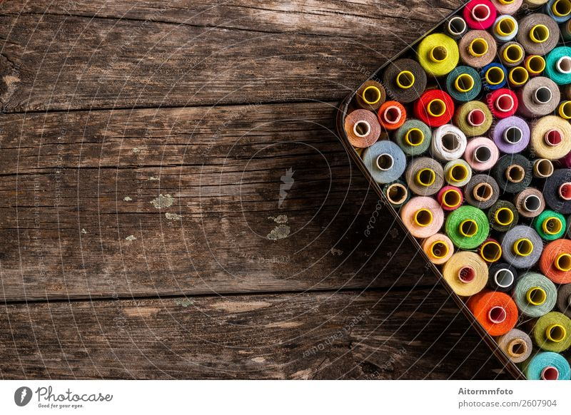 colorful set of sewing spools on wooden table a royalty free stock