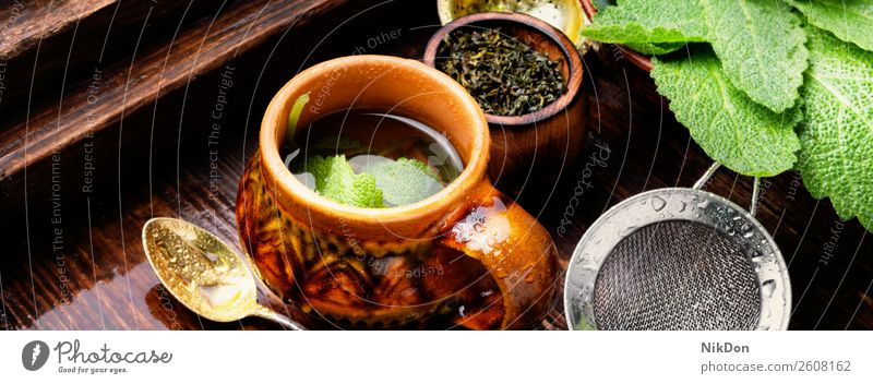 Herbal tea with sage drink cup herb plant hot salvia natural wooden herbal medicine healthy beverage green aroma freshness aromatic medicinal leaf concept rural