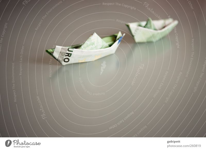 Euro lifeboat Luxury Money Save Paper boat Dinghy Euro symbol Might Envy Tight-fisted Avaricious Lack of inhibition Squander End Success Fairness Decadence