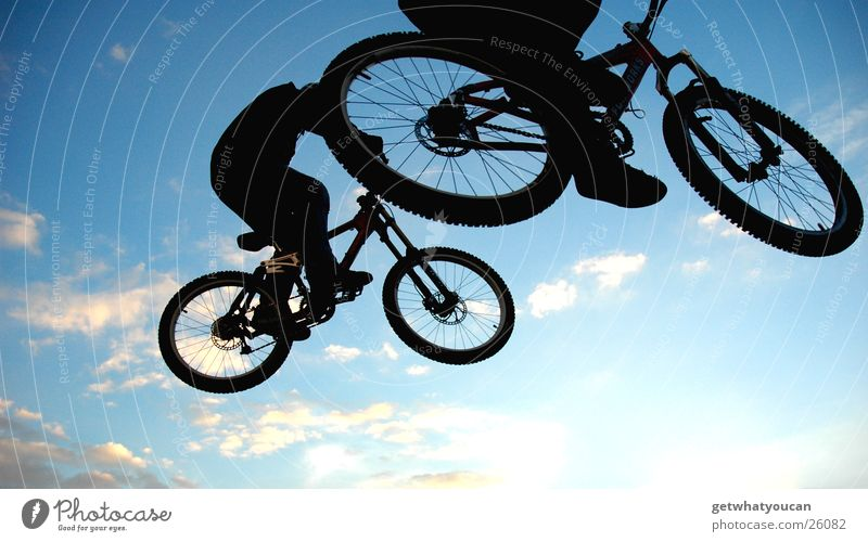 Wheel at the top Bicycle Jump Trick Stunt Ramp Air Back-light Clouds Black Extreme sports Brave Fear Flying street Feet Sky
